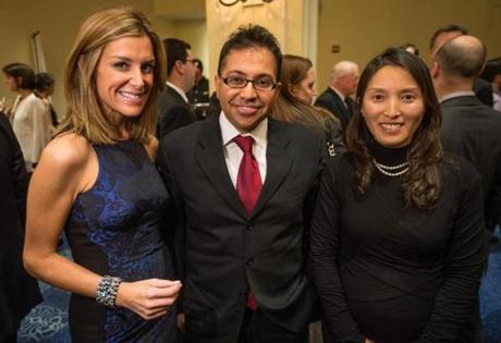 01/Sara Underwood (left) with Dr. Vikram Khurana and his wife, Chee-Yeun Chung.